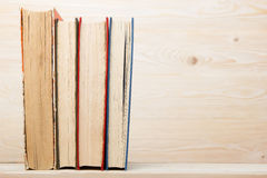 Stack of colorful books on wooden table. Back to school. Copy space.  Stock Image