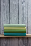 Stack of colorful books on wooden table. Back to school. Copy space.  Royalty Free Stock Photos
