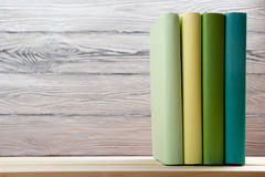 Stack of colorful books on wooden table. Back to school. Copy space.  Stock Photo