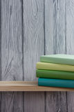 Stack of colorful books on wooden table. Back to school. Copy space.  Royalty Free Stock Photography