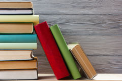 Stack of colorful books on wooden table. Back to school. Copy space stock photography