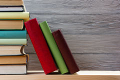 Stack of colorful books on wooden table. Back to school. Copy space.  Stock Images