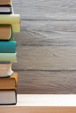 Stack of colorful books on wooden table. Back to school. Copy space.  Royalty Free Stock Image