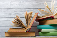 Stack of colorful books on wooden table. Back to school. Copy space.  Stock Photography