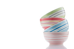 Stack of colorful bowls  on white Royalty Free Stock Image