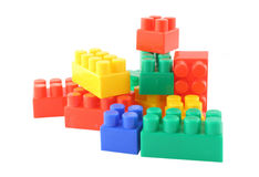 Stack of colorful building blocks. Pure white background, no visible trademarks Royalty Free Stock Photos