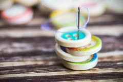 Stack of colorful buttons with sewing needle Royalty Free Stock Photography