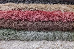 Stack of colorful carpets or rugs background royalty free stock photos