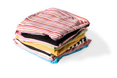 Stack of colorful clothes. Stack of clothes on white background. The photo has a clipping path for your convenience Stock Image