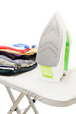 Stack of colorful clothes and iron Royalty Free Stock Photos