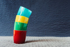 Stack of colorful coffee cups on grunge background Royalty Free Stock Photography