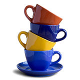 Stack of colorful coffee cups isolated Royalty Free Stock Photos