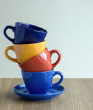 Stack of colorful coffee cups on table Stock Photos