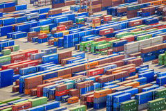 Stack of colorful containers in a port Stock Photo