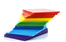 Stack of colorful  corrugated plastic sheets. On white Royalty Free Stock Image