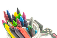 A stack of colorful crayons on an isolated Royalty Free Stock Photo