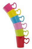 Stack of colorful cups, on white. Stack of colorful cups with heart element on white background Stock Photography