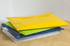Stack of colorful data folders on the office wooden table. royalty free stock photography