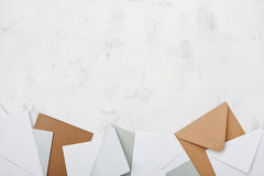 Stack of colorful envelopes on working desk top view. Business mail, blogging and office correspondence background. Flat lay. royalty free stock image