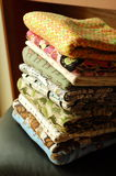 Stack of colorful fabrics. Folded stack of 10 colorful childrens knit fabrics in natural light Royalty Free Stock Image