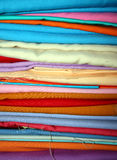 Stack of Colorful Fabrics Stock Photo