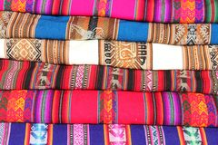 A stack of colorful fabrics. For sale at the Sacred Valley in Peru royalty free stock images