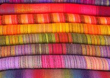 A stack of colorful fabrics. A stack of handwoven colorful fabrics for sale at the Sacred Valley, Peru stock images