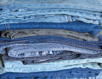 Stack of colorful folded jeans close-up Royalty Free Stock Photo