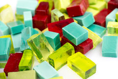 Stack of colorful glass mosaic tiles on white Royalty Free Stock Photography