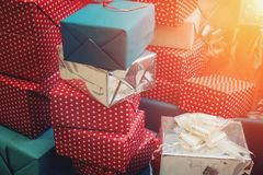 Stack of colorful handmade gift boxes, sunlight effect royalty free stock image