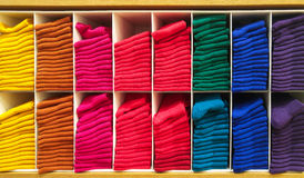 Stack of Colorful Horizontal Various Fluffy Bathing Towels in Wooden Shelf for Shopping Showcase Royalty Free Stock Image