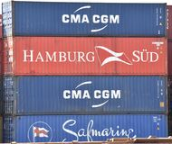 A stack of colorful intermodal shipping containers stock photos