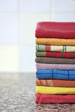 Stack of colorful kitchen towels. A pile of cotton dish towels placed on sink Stock Photos