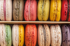 Stack of colorful macaroons stacked up in the box for background. Royalty Free Stock Image