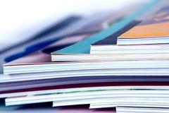 stack of colorful magazines , extreamly DOF stock photography