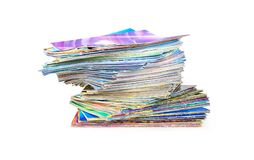 Stack of colorful magazines on white background. Stack of colorful magazines isolated on white background Royalty Free Stock Photography