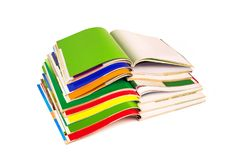 Stack of colorful magazines on white background. Stack of colorful magazines isolated on white background Royalty Free Stock Photo