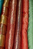 A stack of Indian Sarees. Stack of colorful materials stacked for display in a shop royalty free stock image