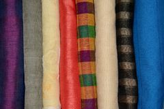 A stack of Indian Sarees. Stack of colorful materials stacked for display in a shop royalty free stock images