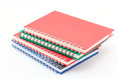 Stack of colorful notebooks. Stock Images