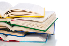 A stack of colorful, open books on a white background Royalty Free Stock Photography