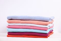 Composition with folded clothes, unisex for both man and woman, different color & material. Pile of laundry, dry clean clothing. Stack of colorful perfectly royalty free stock photo