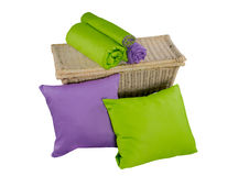Stack of colorful pillows and twisted blankets on basket Royalty Free Stock Photo