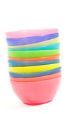 Stack of colorful plastic bowls. Over white background royalty free stock photos