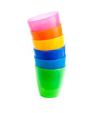 Stack of colorful plastic cups isolated Royalty Free Stock Photos