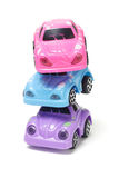 Stack of colorful plastic toy cars Stock Photos