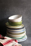 Stack of colorful plates against dark background Stock Image