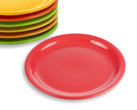 Stack of colorful plates with empty red one Stock Photo