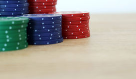 Stack of colorful poker chips on a table. Photo of stack of colorful poker chips on a table stock photo