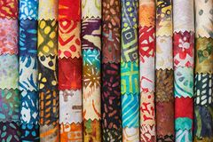 Stack of colorful quilting batik fabrics as a vibrant background image stock image